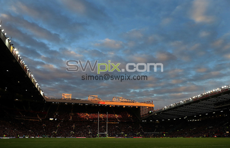 Picture by Vaughn Ridley/SWpix.com - 30/11/2013 - Rugby League - 2013 Rugby League World Cup Final - New Zealand v Australia - Old Trafford, Manchester, England - The sun sets over Old Trafford.