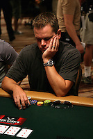 MATT DAMON.The Ante Up for Africa Celebrity Poker Tournament at the Rio Resort Hotel and Casino, Las Vegas, Nevada, USA..July 2nd, 2009.half length table bet betting chips  cards grey gray t-shirt head in hand .CAP/ADM/MJT.© MJT/AdMedia/Capital Pictures