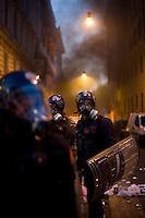 Alcuni carabinieri controllano una strada teatro di atti vandalici da parte dei black block.Carabinieri during the riots in Rome.
