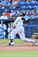 Asheville Tourists third baseman Josh Fuentes (19) swings at a pitch during game one of a double header against the Kannapolis Intimidators at McCormick Field on May 21, 2016 in Asheville, North Carolina. The Tourists defeated the Intimidators in game one 3-2. (Tony Farlow/Four Seam Images)