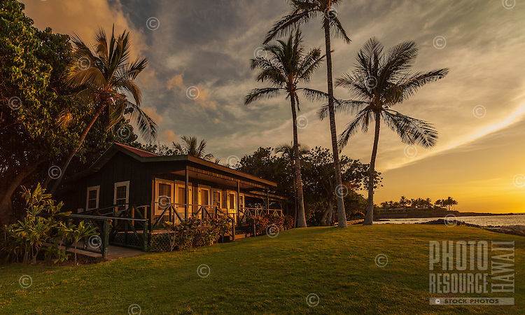Sunset colors reflect on the Eva Parker Woods Cottage, Mauna Lani Bay, Big Island of Hawai'i.