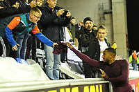 Leroy Fer of Swansea City gives a young fan his shirt at full time of the Sky Bet Championship match between Wigan Athletic and Swansea City at the DW Stadium in Wigan, England, UK. Friday 02 October 2018