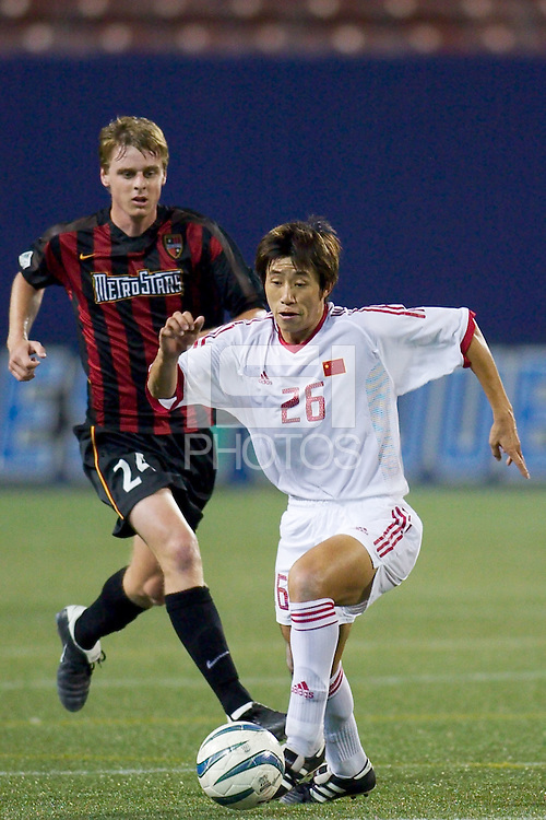 Zheng Bin of China is trailed by Eddie Gaven of the MetroStars. The NY/NJ MetroStars defeated the national team of China 2-1 in a friendly on 9/09/03 at Giant's Stadium, NJ..