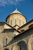 Close up picture & image of the exterior and cupola of the Eastern Orthodox Georgian Svetitskhoveli Cathedral (Cathedral of the Living Pillar) , Mtskheta, Georgia (country). A UNESCO World Heritage Site.<br /> <br /> Currently the second largest church building in Georgia, Svetitskhoveli Cathedral is a masterpiece of Early Medieval architecture completed in 1029 by Georgian architect Arsukisdze on an earlier site dating back toi the 4th century.