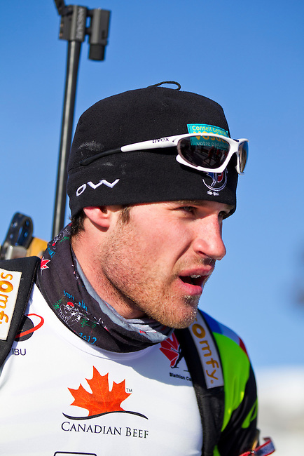 Ludwig Ehrhart of France catches his breath after crossing the finish line at The International Biathlon Union Cup # 7 Men's 10 KM Sprint held at the Canmore Nordic Center in Canmore Alberta, Canada, on Feb 16, 2012.  Ludwig finishes in 25th place in the sprint.  Photo by Gus Curtis