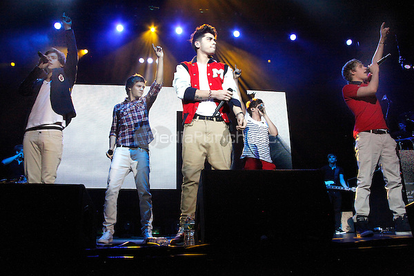 One Direction perform at the SUSQUEHANNA BANK CENTER in Camden, New Jersey on Memorial Day, May 28, 2012  © Star Shooter / MediaPunchInc