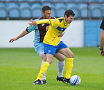 Drogheda United St Johnstone...07.07.11  Pre-season Friendly.Carl Finnigan holds off Robbie Calrk.see story by Gordon Bannerman Tel: 07729 865788.Picture by Graeme Hart..Copyright Perthshire Picture Agency.Tel: 01738 623350  Mobile: 07990 594431