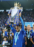 Leicester's Riyad Mahrez celebrates with the trophy during the Barclays Premier League match at the King Power Stadium.  Photo credit should read: David Klein/Sportimage