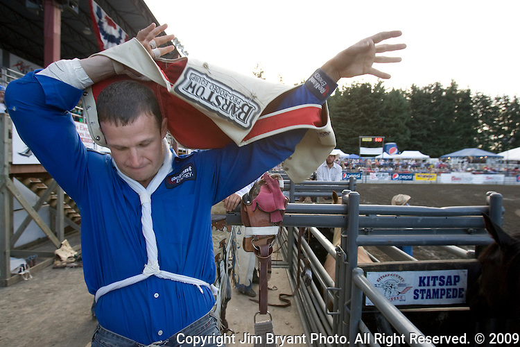 Ranked Number 1 in the world in the Bareback Riding event, Clint Cannon. dons is protective vest  at the Kitsap County Fair and Stampede  Thursday, Aug. 26, 2009. Cannon won the event with an 87.  Jim Bryant Photo. All Right Reserved. © 2009