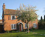 Property released red brick detached village house and garden, Suffolk, England
