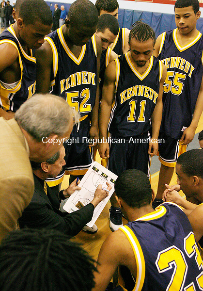 Kennedy's coach Jack Taglia talks to his team during a break in Division L quarter final action at Southington High School Monday night.  The Eagles were defeated by the Indians 59-41  Michael Kabelka Republican / American