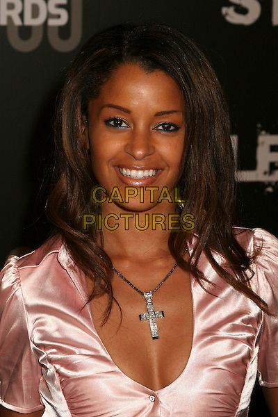"CLAUDIA JORDAN.Stuff Magazine's ""Stuff Style Awards"" at the Arclight Theatre, Hollywood, California, USA..September 27th, 2006.Ref: ADM/BP.headshot portrait cross crucifix necklace.www.capitalpictures.com.sales@capitalpictures.com.©Byron Purvis/AdMedia/Capital Pictures."