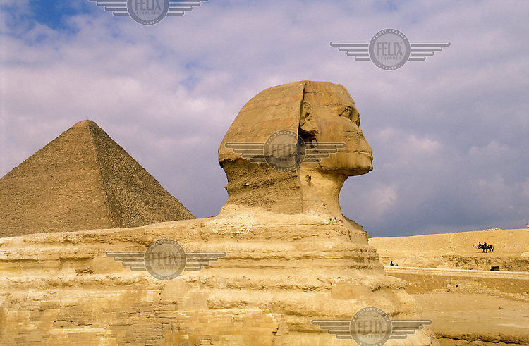 The Sphinx and the Pyramid of Cheops behind.