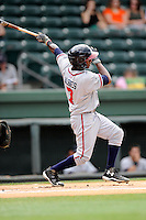 Shortstop Ozhaino Albies (7) of the Rome Braves bats in a game against the Greenville Drive on Sunday, June 14, 2015, at Fluor Field at the West End in Greenville, South Carolina. Rome won, 5-2. (Tom Priddy/Four Seam Images)