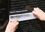 Washington DC; USA: The Vietnam Veterans Memorial on the Mall.  Doing a rubbing of a name of a dead soldier..Photo copyright Lee Foster Photo # 8-washdc82986