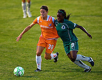 Sky Blue FC defender/midfielder Julianne Sitch (38) and Saint Louis Athletica forward Enoila Aluko (9) during a WPS match at Anheuser Busch Soccer Park, in St. Louis, MO, July 22 2009. Athletica won the match 1-0.