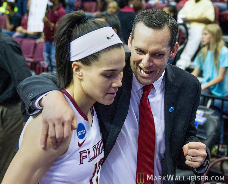 Florida State assistant coach Lance White heads into the locker room with Florida State guard Brittany Brown after the first half of a second-round game of the NCAA women's college basketball tournament against Missouri in Tallahassee, Fla., Sunday, March 19, 2017. (AP Photo/Mark Wallheiser)