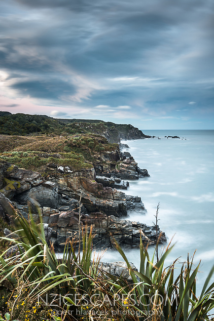 Moody dawn on wild and remote coastline near Charleston near Westport, Buller region, West Coast, New Zealand, NZ