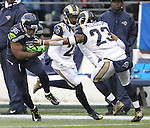 Seattle Seahawks running back Bryce Brown (36) breaks an arm tackle by St. Louis Rams safety Rodney McLeod (23) at CenturyLink Field in Seattle, Washington on December 27, 2015.  The Rams beat the Seahawks 23-17.      ©2015. Jim Bryant Photo. All Rights Reserved
