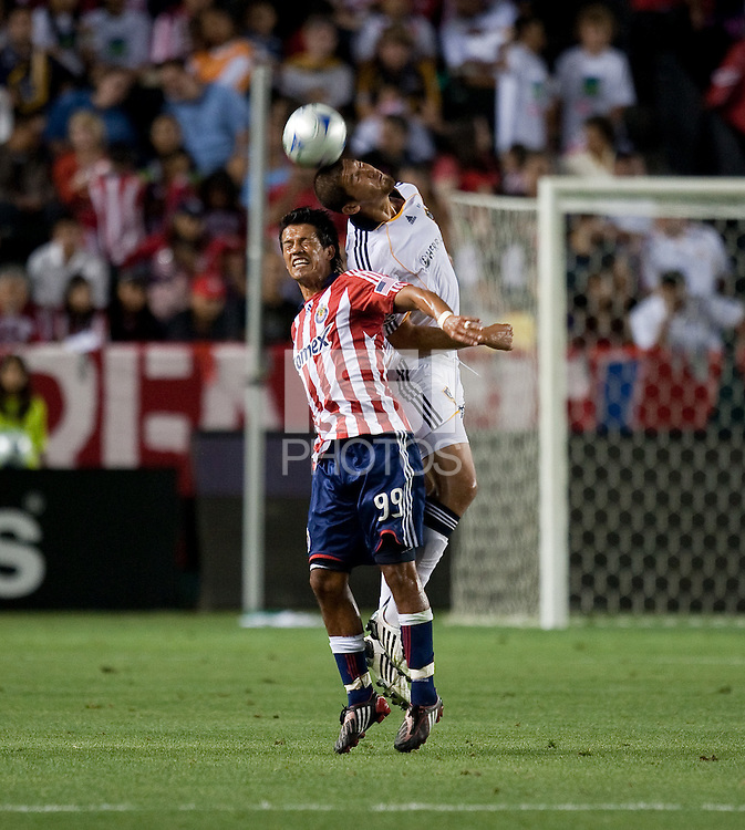 Omar Gonzalez and Eduardo Lillingston go up for the header. The LA Galaxy defeated Chivas USA 1-0 at Home Depot Center stadium in Carson, California Saturday evening July 11, 2009.