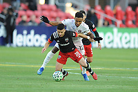 WASHINGTON, DC - MARCH 07: Felipe Martins #18 of D.C. United battles the ball with Luis Argudo #16 of Inter Miami CF during a game between Inter Miami CF and D.C. United at Audi Field on March 07, 2020 in Washington, DC.