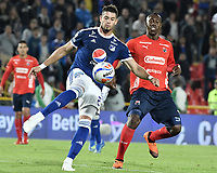 BOGOTA - COLOMBIA, 04-08-2018: Matias De Los Santos (Izq) jugador de Millonarios disputa el balón con Juan F Caicedo (Der) jugador de Deportivo Independiente Medellín durante partido por la fecha 3 de la Liga Águila II 2018 jugado en el estadio Nemesio Camacho El Campin de la ciudad de Bogotá. / Matias De Los Santos (L) player of Millonarios fights for the ball with Juan F Caicedo (R) player of Deportivo Independiente Medellin during the match for the date 3 of the Liga Aguila II 2018 played at the Nemesio Camacho El Campin Stadium in Bogota city. Photo: VizzorImage / Gabriel Aponte / Staff.