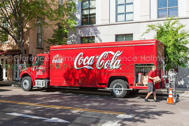 A delivery man unloads a Coca-Cola beverage truck on Meeting Street in Charleston, South Carolina.