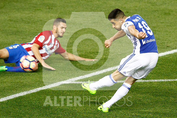 Atletico de Madrid's Koke Resurrecccion (l) and Real Sociedad's Yuri Berchiche during La Liga match. April 4,2017. (ALTERPHOTOS/Acero)