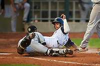 Kane County Cougars catcher Michael Perez (9) dives to tag Rafael P Valera (17) sliding into home during a game against the Cedar Rapids Kernels on August 18, 2015 at Perfect Game Field in Cedar Rapids, Iowa.  Kane County defeated Cedar Rapids 1-0.  (Mike Janes/Four Seam Images)