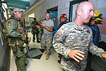 Carson City Sheriff's SWAT members evacuate offices during an active shooter drill at the Adjutant General complex in Carson City, Nev., on Wednesday, July 22, 2015. Nevada National Guard, Carson City Sheriff and Fire departments and Nevada Division of Emergency Management were all part of the exercise. <br /> Photo by Cathleen Allison
