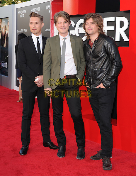 "Isaac Hanson, Taylor Hanson, Zac Hanson of HANSON.""The Hangover Part III"" Los Angeles Premiere held at the Westwood Village Theater, Los Angeles, California, USA..May 20th, 2013.full length black leatherjacket brothers siblings family band group white shirt grey gray tie green suit shirt.CAP/DVS.©DVS/Capital Pictures"