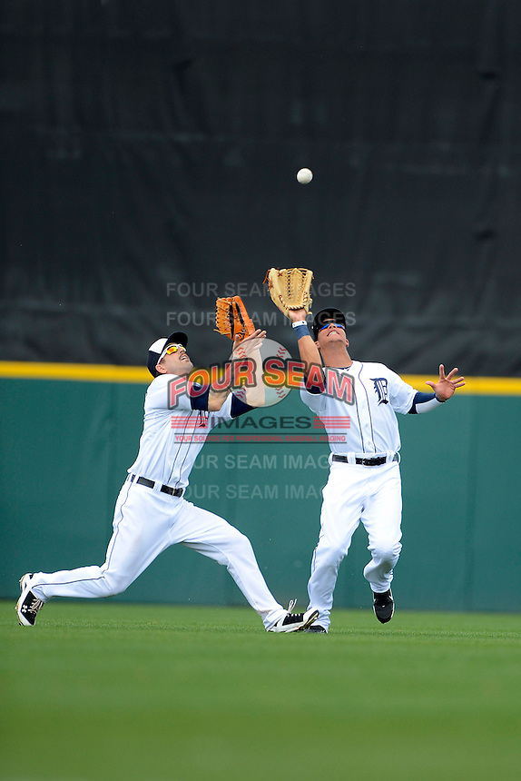 Detroit Tigers outfielders Jeff Kobernus #46 and Quintin Berry #52 look to catch a fly ball during a Spring Training game against the New York Mets at Joker Marchant Stadium on March 11, 2013 in Lakeland, Florida.  New York defeated Detroit 11-0.  (Mike Janes/Four Seam Images)