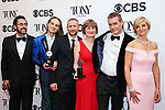 NEW YORK, NY - JUNE 10:   (L-R) Tony Kushner, Jordan Roth, Rowan Ian Seamus Magee, Susan Brown, Rufus Norris and Lisa Burger, of 'Angels in America,' pose in the 72nd Annual Tony Awards Media Room at 3 West Club on June 10, 2018 in New York City.  (Photo by Walter McBride/WireImage)
