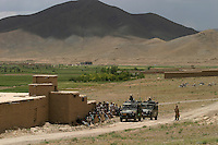 Norwegian ISAF troops surrounded by curiuos locals.  ISAF, the International Security Assistance Force, is a peacekeeping mission affiliated to the United Nations (UN) and NATO.