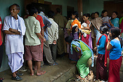 Local villagers line up to cast their vote in a polling booth in village  Kumbi, Manipur, India. About 62 per cent of 8,02,000 voters exercised their franchise in an incident-free secondphase of Lok Sabha elections for the prestigious Inner Manipur parliamentary constituency on April 22nd 2009.