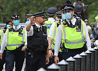 """It seemed strange that when a large gathering like a demonstration was held, Police would be in close proximity with protesters but not wearing a face covering. Recently a change in policy has meant that in some situations where social distancing is impossible, they will. A spokesperson said: """"If officers cannot maintain a two metre gap and where there is a possible risk of infection, our policy is now that officers will wear a facemask, which all officers have readily available."""" London on 9th September 2020<br /> <br /> Photo by Keith Mayhew"""