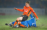 St Johnstone v Dundee United....22.02.11 .Paul Dixon is tackled by Dave Mackay.Picture by Graeme Hart..Copyright Perthshire Picture Agency.Tel: 01738 623350  Mobile: 07990 594431