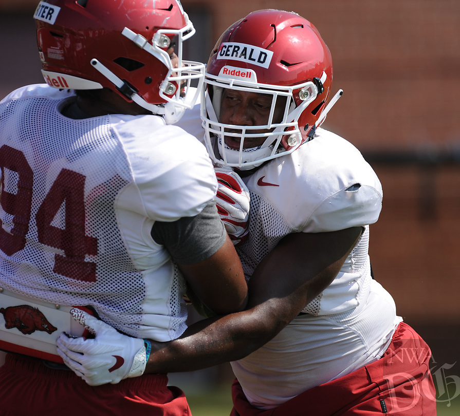 NWA Democrat-Gazette/ANDY SHUPE<br /> Arkansas defensive lineman Dorian Gerald (right) wraps up David Porter Tuesday, Aug. 6, 2019, during practice at the university practice field. Visit nwadg.com/photos to see more photographs from the practice.