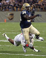 Youngstown safety Jeremey Edwards makes an ankle tackle on Pitt running back Isaac Bennett. The Youngstown St. Penguins defeated the Pittsburgh Panthers 31-17 on Saturday, September 1, 2012 at Heinz Field in Pittsburgh, PA.