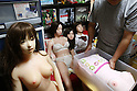 July 5, 2010 - Tokyo Japan - Ta-bo, an avid Love Doll collector, takes out a head of a Love Doll, with other Love Dolls sitting behind him in Tokyo, Japan, on July 5, 2010. The 50-year-old Japanese engineer who rents a special three-bedroom apartment for his Love Dolls, says he owns more than one hundred, which is, to his mind, the world's largest collection of its kind.