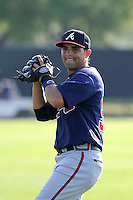 Second baseman Jose Peraza (57) of the Atlanta Braves farm system warms up before a Minor League Spring Training intrasquad game on Wednesday, March 18, 2015, at the ESPN Wide World of Sports Complex in Lake Buena Vista, Florida. (Tom Priddy/Four Seam Images)