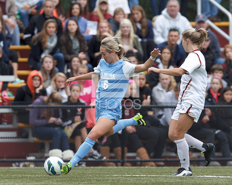 University of North Carolina forward Summer Green (6) crosses the ball.   University of North Carolina (blue) defeated Boston College (white), 1-0, at Newton Campus Field, on October 13, 2013.