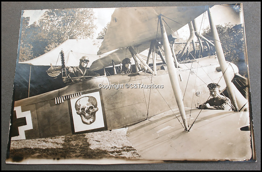 BNPS.co.uk (01202 558833)<br /> Pic: C&TAuctions/BNPS<br /> <br /> An Imperial German aircraft with the pilot and gunner sitting inside. <br /> <br /> A photograph of a German pilot with a British flyer he had shot down before they went off for coffee together has emerged to highlight the remarkable chivalry that existed between the rival air forces in the First World War.<br /> <br /> Captain Oswald Boelcke, a legendary air ace regarded as the father of the German fighter air force, is stood next to Capt Robert Wilson, who had to beat out the flames on his legs and arms after being forced to crash-land his bi-plane behind enemy lines in 1916.<br /> <br /> The photo has emerged in an album of 105 black and white pictures relating to the First World War.