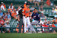 Baltimore Orioles third baseman Steve Tolleson (18) on third after Engelb Vielma (1) hit a triple during a Spring Training game against the Minnesota Twins on March 7, 2016 at Ed Smith Stadium in Sarasota, Florida.  Minnesota defeated Baltimore 3-0.  (Mike Janes/Four Seam Images)