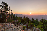 June 2016 - Sunrise from the summit of Mount Tecumseh in Waterville Valley, New Hampshire. This viewpoint is man-made and is the result of unauthorized tree cutting. Forest Service is trying to determine who cut the trees down.