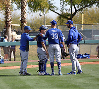 Mookie Betts (far left) gives a fist bump to pitcher David Price (#33) after the latter's first live batting practice session at the Los Angeles Dodgers spring training facility at Camelback Ranch on February 21, 2020 in Glendale, Arizona. Catcher Austin Barnes and pitching coach Mark Prior are also present (Bill Mitchell)