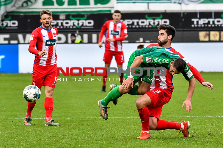 01.12.2019, Voith-Arena, Heidenheim, GER, DFL, 1. FC Heidenheim vs SpVgg Greuther Fürth, <br /> DFL regulations prohibit any use of photographs as image sequences and/or quasi-video, <br /> im Bild Maximilian Wittek (Fuerth, #3) mit Flugeinlage, Zweikampf mit Stefan Schimmer (Heidenheim, #9)<br /> <br /> Foto © nordphoto / Hafner