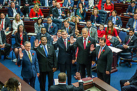 TALLAHASSEE, FLA. 11/22/16-Rep. Charles Wesley &quot;Chuck&quot; Clemons, Sr., R-Newberry, left, Rep. Patrick Henry, D-Daytona Beach, Rep. Stan McClain, R-Belleview, Rep. Bobby Payne, R-Palatka, and Rep. Thomas J. &quot;Tom&quot; Leek, R-Ormond Beach take the oath of office from <br /> Judge Nicholas Thompson during the organizational session of the legislature at the Capitol in Tallahassee.<br /> <br /> COLIN HACKLEY PHOTO