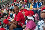 HSBC guests attend the Cathay Pacific / HSBC Hong Kong Sevens at the Hong Kong Stadium on 28 March 2014 in Hong Kong, China. Photo by Leena Chatlani / Power Sport Images