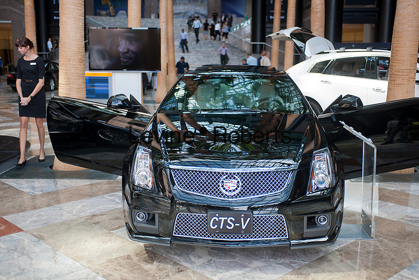 Customers examine Cadillac luxury vehicles on display at the Motorexpo in the World Financial Center in New York on Wednesday, September 19, 2012. The luxury car show hopes to attract an affluent audience, being in the World Financial Center with Goldman Sachs, American Express and the NY Mercantile Exchange in the immediate vicinity. The show is free to anyone. (© Richard B. Levine)